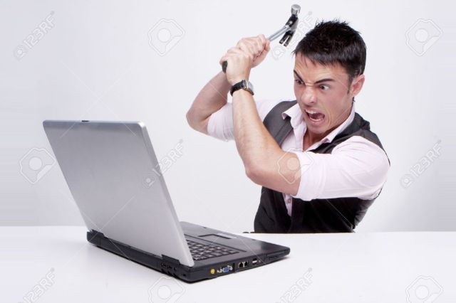 5011395-Brunette-businessman-looks-at-his-computer-in-disbelief-killing--Stock-Photo